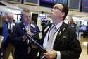 Trader Joseph Murray, right, works on the floor of the New York Stock Exchange, Thursday, Aug. 9, 2018. Stocks are off to a mixed start on Wall Street as gains for technology companies are offset by losses elsewhere in the market. (AP Photo/Richard Drew)