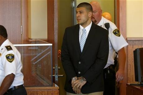 Former NFL player Aaron Hernandez enters the courtroom for a hearing in Bristol County Superior Court in Fall River