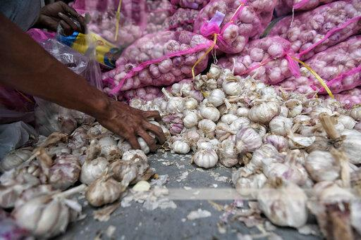 Low-cost market garlic operation in Bandung, West Java- 18 February 2020.