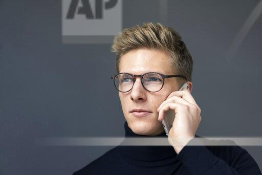 Portrait of young man on cell phone