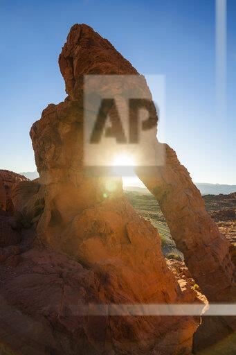 USA, Nevada, Redrock sandstone arch at sunrise in the Valley of Fire State Park