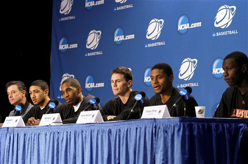 Rick Pitino, Peyton Siva, Chris Smith, Kyle Kuric, Chane Behanan, Gorgui Dieng