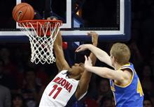 Allonzo Trier, Thomas Welsh