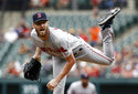 Boston Red Sox starting pitcher Chris Sale follows through on a pitch to the Baltimore Orioles in the first inning of a baseball game, Sunday, Aug. 12, 2018, in Baltimore. (AP Photo/Patrick Semansky)