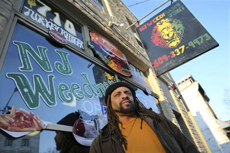 """Ed Forchion, a pro-marijuana activist known as NJ Weedman, stands in front of his Weedman's Joint restaurant Monday, March 7, 2016, in Trenton, N.J. After years of legal fights over marijuana from coast to coast, NJ Weedman appeared to be going legit with a new restaurant in New Jersey's capital city. But after Trenton officials shutdown the attached cannabis """"temple"""" Saturday night for operating too late at night, Forchion says he's headed back to court. (AP Photo/Mel Evans)"""