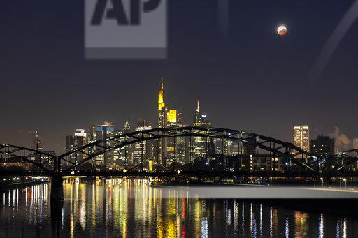 Germany, Frankfurt on Main, view to lighted skyline with Deutschherrn Bridge at total lunar eclipse