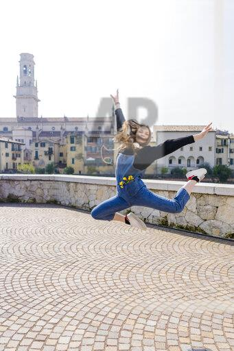 Young woman jumping in Verona