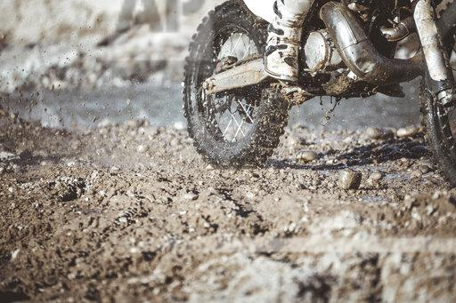 Close-up motocross wheel with water and mud