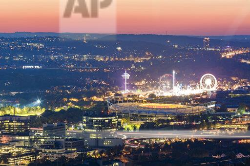Germany, Baden-Wuerttemberg, Stuttgart, Bad Cannstatt, Mercedes-Benz Factory, Mercedes-Benz Arena and Cannstatter Wasen at night