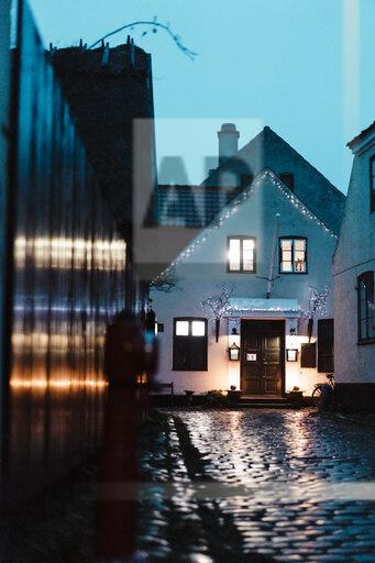 Denmark, Dragor, lighted house in the old town at twilight