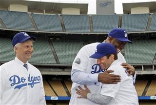 Mark Walter, Magic Johnson, Peter Guber