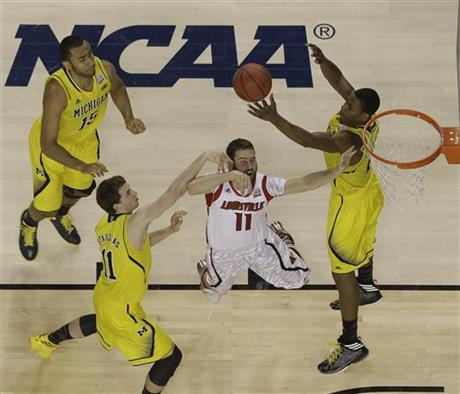AP TOPIX NCAA Final Four Michigan Louisville Basketball