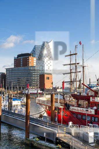 Germany, Hamburg, Sailing ship moored in harbor with Elbe Philharmonic Hall in background