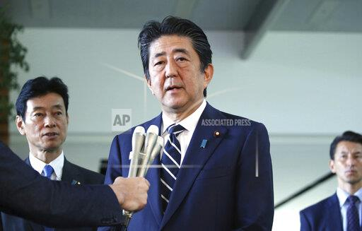 Japan's PM Shinzo Abe speaks to media