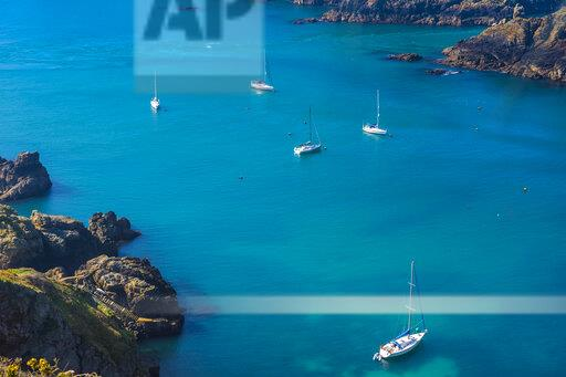 United Kingdom, Channel islands, Sark, sailing boats off shore the island of Brecqhou