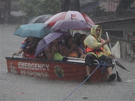 CORRECTION APTOPIX Philippines Floods