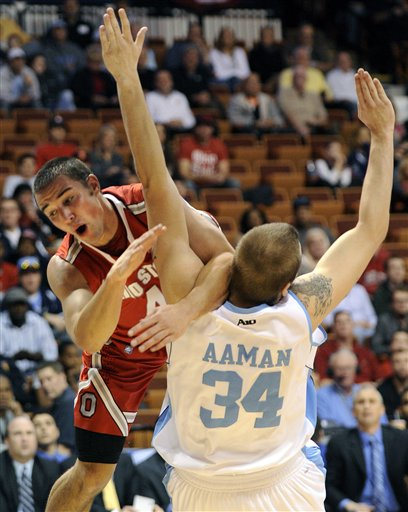 Aaron Craft, left, Mike Aaman