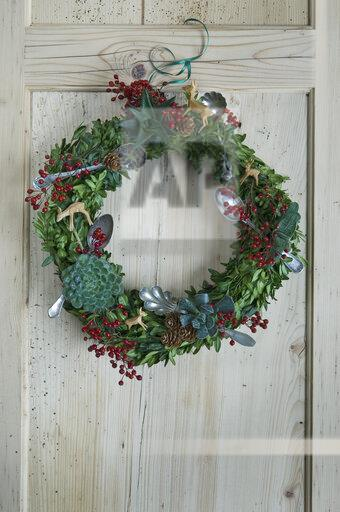 Advent wreath hanging at wooden door