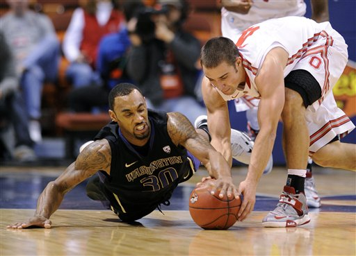 Aaron Craft, right,  Desmond Simmons