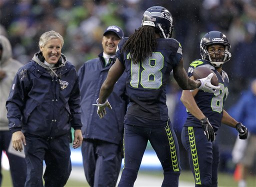 Pete Carroll, Sidney Rice, Golden Tate