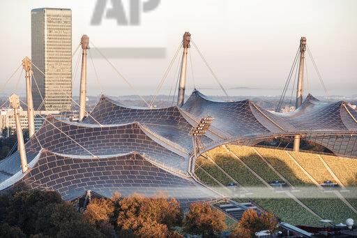 Germany, Munich, Olympic Park, Olympic Stadium, tent roof construction in the morning light