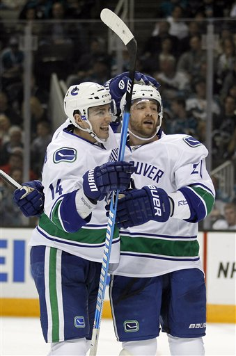 Alex Burrows, Chris Higgins