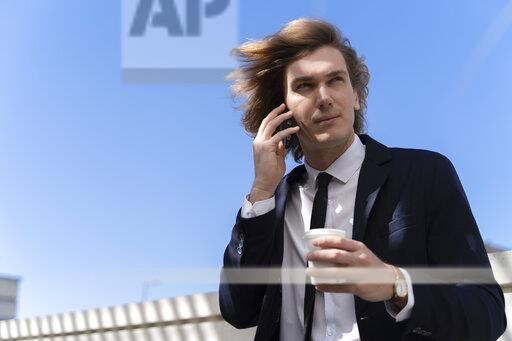 Italy, Florence, young businessman using smartphone outdoor