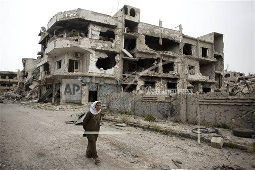 APTOPIX Mideast Syria Returning to Homs
