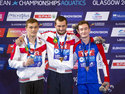Men's 10m Platform Final medal winners, pose from left to right, Russia's Nikita Shleikher with silver, Russia's Aleksandr Bondar with gold, and France's Benjamin Auffret with bronze, during the European Championships at the Royal Commonwealth Pool in Edinburgh, Scotland, Sunday Aug. 12, 2018. (Ian Rutherford/PA via AP)