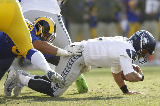 1314f3e71 The Latest  Fowler strip sack helps Rams up lead on Seattle