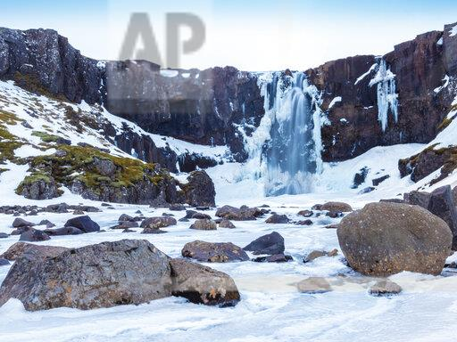 Iceland, Gufufoss waterfall frozen in winter before sunrise