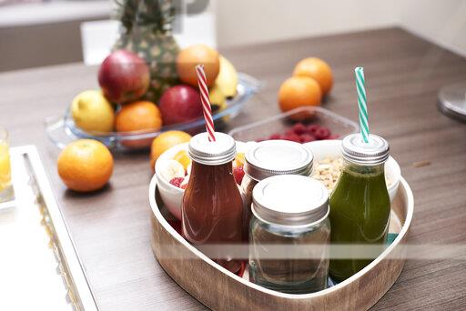 Tray with healthy breakfast on kitchen counter