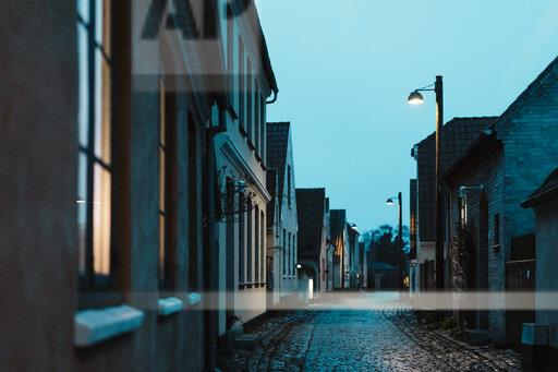 Denmark, Dragor, empty alley at blue hour