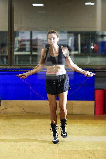 Female boxer skipping rope in a gym