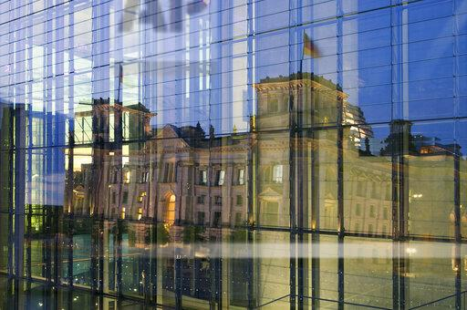 Germany, Berlin, Berlin-Mitte, reflection of the Reichstag building in a glass faceade