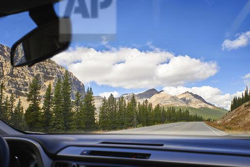 Canada, Alberta, Jasper National Park, Banff National Park, Icefields Parkway, road and landscape seen through windscreen