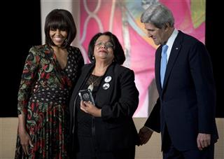 John Kerry, Michelle Obama, Julieta Castellanos
