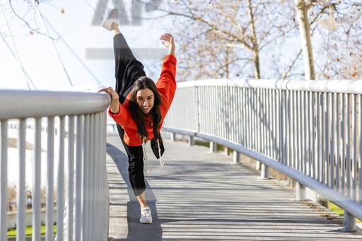 Young contemporary dancer on a footbridge