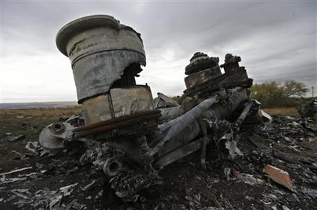 Pieces of the Malaysia Airlines Flight 17 plane are seen near village of Hrabove, eastern Ukraine, Tuesday, Sept. 9, 2014. (AP Photo/Sergei Grits)