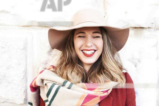 Portrait of a happy stylish woman wearing a floppy hat