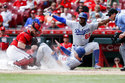 Los Angeles Dodgers' Joc Pederson (31) scores against Cincinnati Reds catcher Tucker Barnhart, left, as Yasiel Puig (66) reacts in the fifth inning of a baseball game, Wednesday, Sept. 12, 2018, in Cincinnati. (AP Photo/John Minchillo)