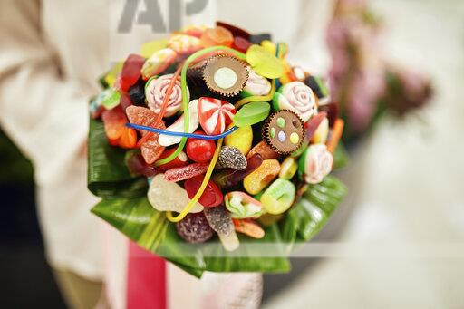 Close-up of woman holding candy bouquet