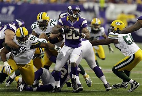 Adrian Peterson, B.J. Raji, Ryan Pickett, Dezman Moses