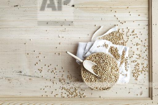 Organic buckwheat, whole grains in bast bowl on wood, from above