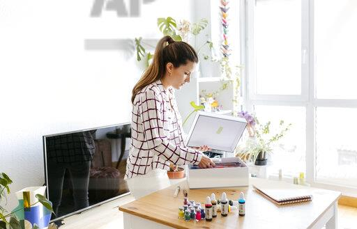Woman at home preparing for painting