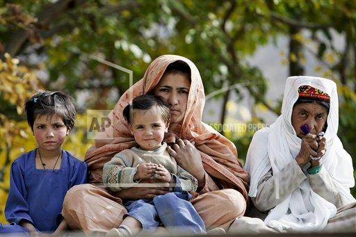 Creative Robert Harding Productions /AP Images A   Pakistan 1161-2616 Pakistani family in mountain village of Altit in Hunza region of Karokoram Mountains, Pakistan