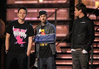 Mark Hoppus, Travis Barker, Tom DeLonge