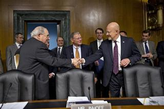 James R. Clapper, Carl Levin, James Inhofe