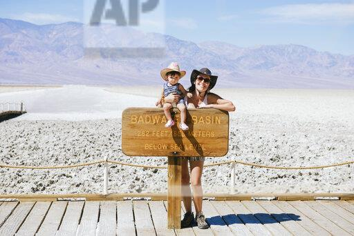 USA, California, Death Valley National Park, Badwater Basin, portrait of happy mother and baby girl