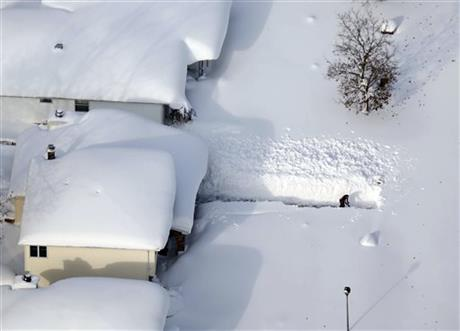A man digs out his driveway in Depew, N.Y.,Wednesday, Nov. 19, 2014.